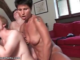 Horny old woman with short brunette hair