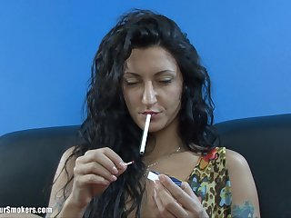 Adult brunette with long hair smoking before masturbating way down