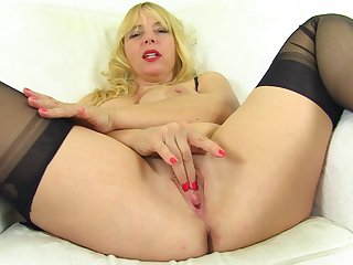 Zesty mature blonde with big tits opens her legs for sexy unsurpassed admiration