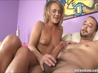 Horny mature Amber loves to pleasure a big dick just about her hands
