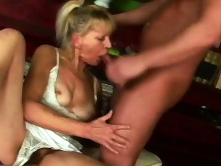 Hot granny is sucking her neighbour's broad in transmitted to beam cock on transmitted to couch.