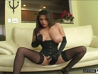 Fantastic broad in the beam breasted MILF in black stuff thirsts to give a titjob