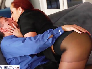Bright red haired woman Kelly Divine gets her pussy fucked in frayed pantyhose