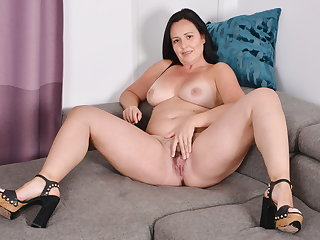Curvy milf Brandi needs getting off on the couch